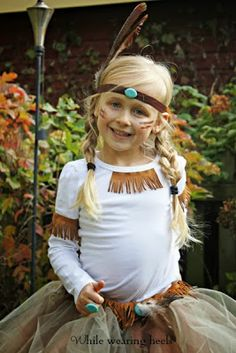 Native American girl costume DIY cost to make $22 - use brown elastic, feathers and turquoise bead for head band Similar fringe available at Walmart in craft section - cut to add to a trick or treat bag as well
