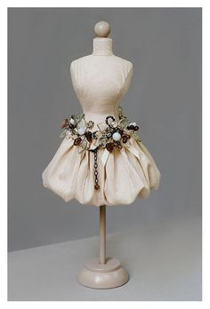 Mannequin Madness.com sells miniature dress forms so you can create DIY projects like this.
