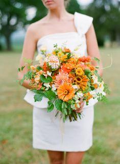Cheerful orange bridal bouquet | http://burnettsboards.com/2014/01/tomato-themed-wedding/