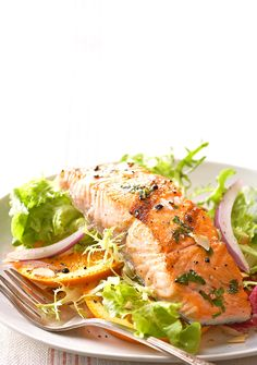 For a light and refreshing lunch, top mixed greens with a citrus dressing and grilled salmon fillets.