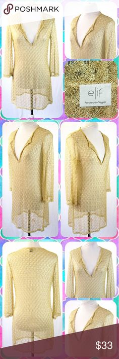 "Gold Metallic Cover Up Swim Tunic Size 10/M Beautiful Gold Metallic Beach Tunic by Elif for Jordan Taylor! This semi-sheer swim top is lightweight with a fine gold weave throughout. V-neckline and 3/4 length sleeves. Popover styling. Polyester blend. Size M or 10. Measures 18"" across the chest and 33"" in length. So pretty! Elif for Jordan Taylor Swim Coverups"
