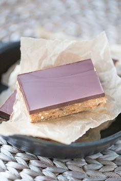 These gluten free Homemade Snack Bars are packed with raw cashews and almonds, dates and coconut flour. They're sweetened with honey and maple syrup. And for an extra boost of flavor, they're topped with a delicious layer of dark chocolate!