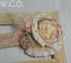 the MARGUERITE Couture Boutique Style Flower and Rosette Stretch Lace Headband