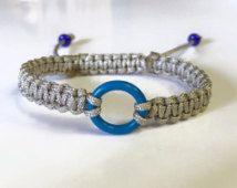 Ringette Bracelet, Blue Ring Ringette Grey Nylon Braided Charm Bracelet