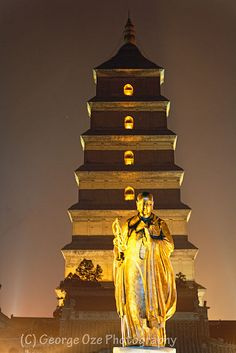 The Big Wild Goose Pagoda with the Statue of Xuanzang Sanzang at Night, Xian, Shaanxi, China by George Oze, via Flickr