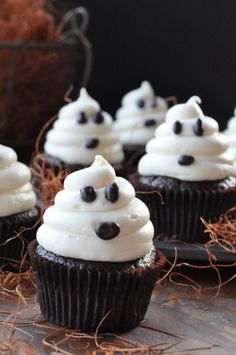 20 Sweet and Easy Treats for Halloween Party//ghost cupcakes. You could tweek this for almost any holiday treat: use m&ms (tiny ones work best) or choc chips for eyes--red one for a nose and mini pretzels for the reindeer antlers; place mini pumpkins and/or candy corn for Thanksgiving or fall treats, etc. Use your imagination :)