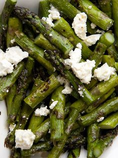 Grilled asparagus with feta, lemon zest, and olive oil.
