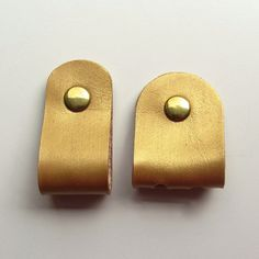 Earbud / earphone / cable organizers in gold painted vegetable tanned leather handmade by RinartsAtelier,