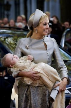 Princess Máxima Zorreguieta Cerruti (1971-living2013) Argentina wife of Prince Willem-Alexander (Willem-Alexander Claus George Ferdinand) (1967-living2013) Prince of Orange, Netherlands heir holding 3rd child, Princess Ariane for her christening.