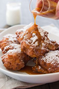 Crisp on the the outside and tender on the inside, these banana fritters are loaded with big chunks of caramelized banana and are drizzled with vanilla caramel sauce.