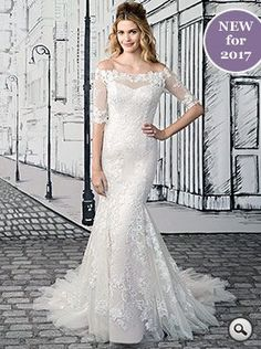 Justin Alexander 8903 // Off the Shoulder Lace Gown with Elbow Illusion Lace Sleeves. Fall in love with this off-the-shoulder, fit-and-flare gown with all-over sequin lace appliqués. Elbow length Illusion sleeves, an Illusion back and a Chapel length train.