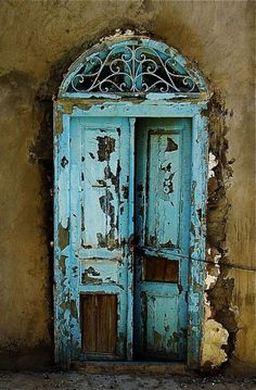 just beautiful..everything about it from color to chippy paint, shape. and iron work at top...