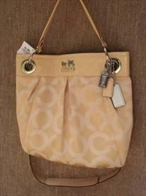 NEW COACH HANDBAG-This Coach Madison Op Art Hippie bag has widespread appeal. List Price: $140