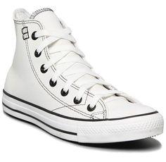 Tênis branco está em alta na moda.