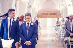 Groom waits for bride at The Tithe Barn wedding venue. Photography by one thousand words wedding photographers