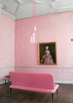 pink dream | pink walls and a pink statement chair with retro pink hanging lights from tall white ornate ceiling rococo painting of marie antoinette