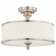 """Featuring a brushed nickel finish and pleated fabric shade, this timeless semi-flush mount casts a warm glow in your foyer or dining room.    Product: Semi-flush mountConstruction Material: Metal and fabricColor: Brushed nickel and white Features: Pleated drum shade 5.5"""" Canopy diameter 12"""" Wire length UL and cUL listed for dry locations 120 Volts Hardwired and junction box connections  Accommodates: (3) 60 Watt A19 medium base bulbs - not includedDimensions: 7.5"""" H x 15"""" Diameter"""