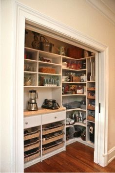 Great pantry...love the sliding door! There is a place for everything all in one place, slots for serving trays, drawers for canned goods, shelves that wrap around the corner for better storage, heavy chrome baskets that glide out to hold all those items that get lost amongst everything else