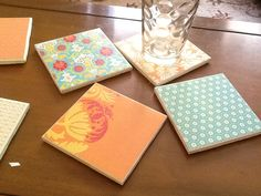 Tile coasters. Mod podge + scrapbook paper