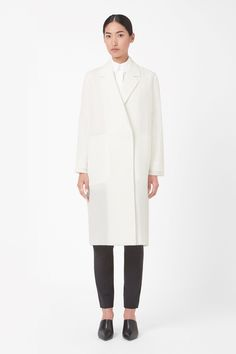 A clean, modern style, this oversized coat is made from lightweight scuba with sharp laser-cut edges. A straight shape with a high back vent, it has wide notched lapels, hidden front zip fastening and deep in-seam pockets.