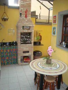 Cozinha de área gourmet rústica.