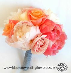 B027 - Posy of salmon, pink and ivory roses and peonies, bound in navy and white stripe ribbon. Fluffy posy for bridesmaid