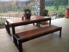 Wooden Picknick table. Romantic. Warm. Garden furniture. Steel and wood.