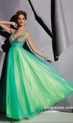 http://www.ikmdresses.com/2014-V-Neck-Beaded-Tulle-Bodice-Pleated-Waistband-With-Tulle-Skirt-Prom-Dress-p84552