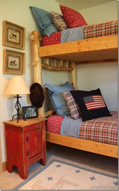 Red, white & blue boys' bedroom with custom bunk beds, Ralph Lauren linens and vintage horse artwork. #western