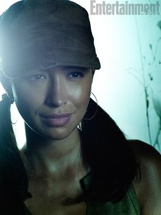 I don't mean to make these photos all about the hair, but how killer are Rosita's double ponytails? And the hat? The hoop earrings? It's...