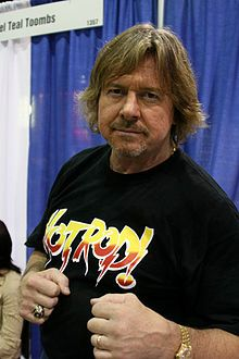 """Roderick """"Roddy"""" George Toombs (born April 17, 1954),[2] better known by his ring name """"Rowdy"""" Roddy Piper, He earned the nickname """"Rowdy"""" by displaying his trademark """"Scottish"""" rage, spontaneity and quick wit. Despite being a crowd favorite for his rockstar-like persona, he often played the villain. He was also nicknamed """"Hot Rod"""""""