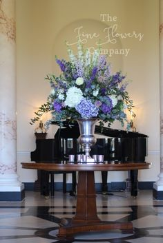 silver urn flowers wedding centrepiece of tall ivory and purple delphiniums, ivory and purple hydrangeas and stocks, from wedding reception at Botleys Mansion. silver urn flowers wedding centrepiece of tall ivory and Wedding Flower Photos, Wedding Reception Flowers, Purple Wedding Flowers, Wedding Blue, Reception Food, Altar Flowers, Church Flowers, Funeral Flowers, Flowers Decoration