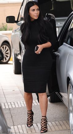 Bling bling: Kim flashed her huge engagement ring from Kanye, who she celebrated her first...