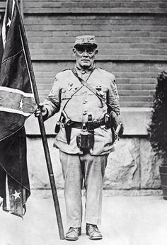 1922 Richmond, Virginia - J. F. Griffin, at 81 the last surviving member of the Louisiana Tigers, holds a Second Naval Jack flag at the 32nd Annual Reunion of the United Confederate Veterans at Richmond.