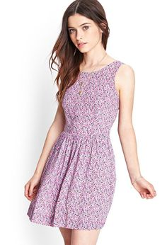 A soft, watery floral print and a cutout back with bow details give this dress a sweet, vintage v...