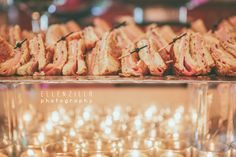 ham and cheese sandwiches warmed by tealights!  mm mmm!! great idea for a party snack, or great for all of the upcoming holiday food tables! love these ham and cheese sandwiches warmed by tea lights. beautiful set up, don't you think?