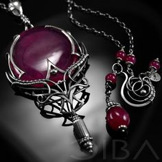 Ohndria  An exclusive, sterling silver necklace with a large HQ ruby cabochon.  Take even the simplest outfit to the next level with this gorgeous, original and elegant design. A showcase piece, this necklace shines by itself without the need for other jewelry. A perfect gift for yourself or someone special!  CIBA artistic jewelry can unexpectedly and completely change the character of an outfit. Try it and see for yourself!  Commission.