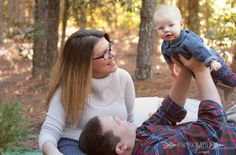 Christmas family photo idea. Holiday colors in a pine forest. Outdoor photo shoot. Christmas photos with baby. Perfect photoshoot style.  Tampa Area family photographer.