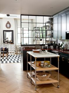 Black and white kitchen and dining space with checkered tile