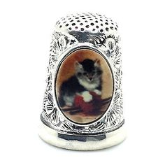 VICTORIAN STYLE THIMBLE WITH ENAMEL KITTEN AND EMBOSSED FLOWER STERLING SILVER.