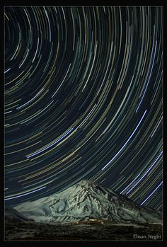 Star trails over a mountain Ehsan Negin from Iran This image shows two hours of Earth's rotation. With a stationary camera, stars produce trails across the sky. The foreground features the stratovolcano Mount Damavand, the highest peak in Iran. (Canon EOS 50D DSLR, 18-135mm lens set at 18mm and f/3.5, ISO 1200, two hundred and forty 30-second exposures, stacked)