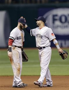 Boston Red Sox's Dustin Pedroia left and Shane Victorino celebrate after the team defeated the Tampa Bay Rays in 14 innings during a baseball game Tuesday June 11 2013 in St. Red Sox Baseball, Baseball Players, Boston Sports, Boston Red Sox, Dustin Pedroia, No Crying In Baseball, Red Sox Nation, America's Pastime, Boston Strong