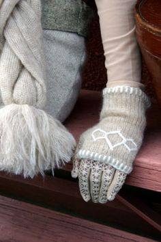 Lace gloves with mitts over them.  Sweet.