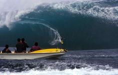 Alain Riou rides a wave at Teahupoo in Tahiti on May 14, 2013.