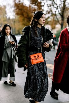 A pop of orange in your outfit will elevate it in a creative way