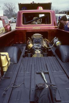 A peek at the 426 Hemi in the rear of the Little Red Wagon