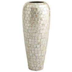 Good thing capiz is naturally abundant. There are so many ways to show off its shimmer. Crafted by hand, this vase features rows of square shells embedded in earthenware and finished with a smooth lacquer. Well, actually, the look isn't complete until it's set atop your table. Whether you fill it with dried florals or leave perfectly well alone, that's where your decorative genius comes into play.