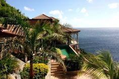 tropical exterior by Barefoot Design Group, LLC