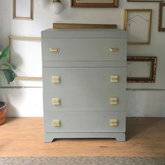 Smooth grey mid century dresser with amazing original (well the bottom six) pulls.  now in my booth @curiositiesvintage #midcentury #vintage #furniture