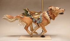 Cali the dog, as a carousel animal. Photo and carving: Tim Racer